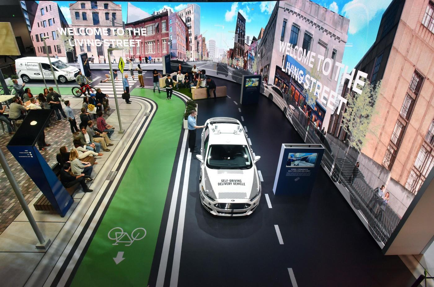 【CES 2018】不停揪企業組自駕車隊,福特這次瞄準「快遞服務」找新出路