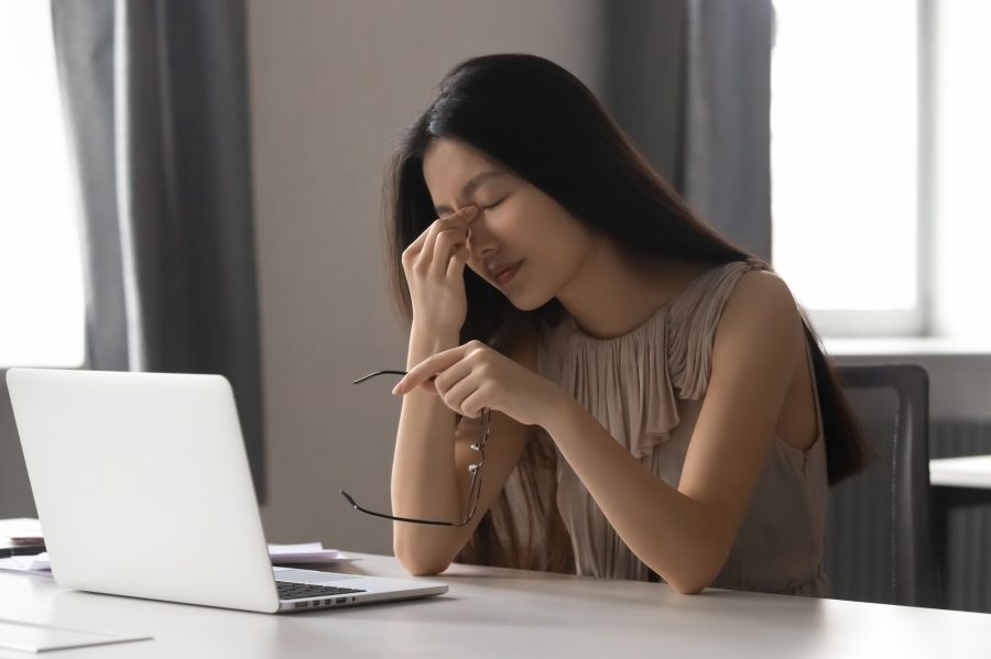 Overworked stressed asian business woman employee